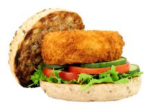 Fish Cake Sandwich. Breadcrumb covered fish cake and salad sandwich isolated on a white background Stock Photos