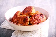 Fish cakes in a bowl. On table Stock Image