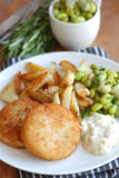 Fish cakes with chips Stock Image