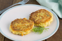Fish cakes with dill. On plate Royalty Free Stock Image