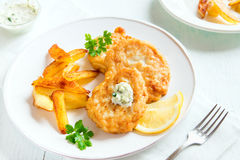 Fish cakes with french fries stock photo