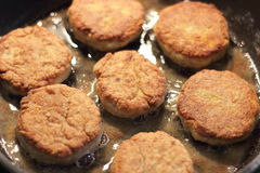 Fish cakes on a hot oil Stock Images