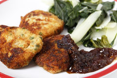 Fish cakes with onion marmalade Royalty Free Stock Photos