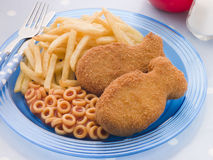 Fish Cakes with Spaghetti Hoops and Chips. Close up of Fish Cakes with Spaghetti Hoops and Chips Royalty Free Stock Photography