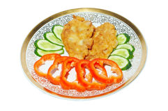 Fish cakes and vegetables Stock Image