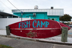 Fish Camp sign on Red Boat. Fish Camp sign written on red fishing boat outside of blue building on the coast of Florida in small town of Dunedin, Florida Stock Photography