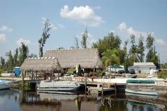 Fish Camp Tiki Bar. The Tiki Bar at a fish camp on the Peace River near Punta Gorda Florida royalty free stock image