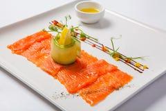 Fish carpaccio. Carpaccio of salmon on white plate Stock Image