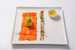 Fish carpaccio. Carpaccio of salmon on white plate Stock Images