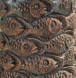 Fish carved on a tree Stock Photo