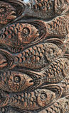Fish carved on a tree Stock Photography