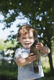 Fish caught in the hands of a smiling little boy. A sunny summer day. royalty free stock photo