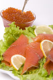 Fish and caviar. Red fish lettuce lemon and caviar Royalty Free Stock Photo
