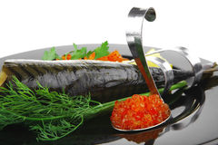 Fish and caviar on plate Royalty Free Stock Photography