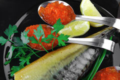 Fish and caviar on plate Royalty Free Stock Photos
