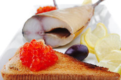 Fish and caviar on toast Stock Photos