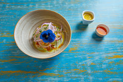 Fish ceviche preuvian recipe and pansy flower Royalty Free Stock Photos