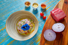 Fish ceviche preuvian recipe and pansy flower Royalty Free Stock Photo