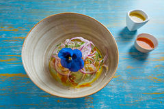 Fish ceviche preuvian recipe and pansy flower Stock Photos