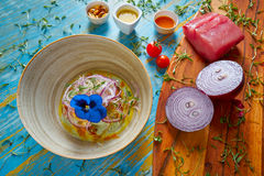 Fish ceviche preuvian recipe and pansy flower Stock Images