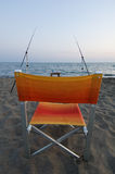 FISH CHAIR. CHAIR WAITING FOR FISHING ON SUNSET Royalty Free Stock Images