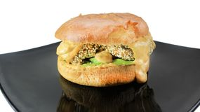 Fish cheese burger with the cheese sauce and aioli stock photos