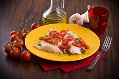 Fish with cherry tomatoes and olive. Stock Photos