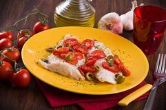 Fish with cherry tomatoes and olive. Stock Photography