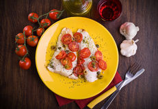 Fish with cherry tomatoes and olive. Stock Image