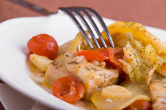 Fish, cherry tomatoes and potatoes. Stock Images