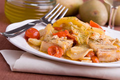 Fish, cherry tomatoes and potatoes. Royalty Free Stock Photography