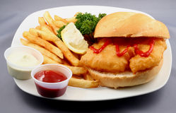 Fish and Chip Combo Meal. Fish Sandwich and French Fries with sauces on the side Stock Photo