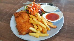 Fish and chip with salad and sauce. In white dish Stock Photo