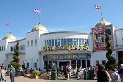 Fish and Chip shop advertised on Clacton Pier Stock Photography