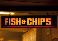 Fish and chip shop neon sign Stock Photography