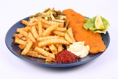 Fish and chips. British cuisine: Fish and chips with some runner beans, ketchup and mayonnaise, decorated with lemon and lettuce Stock Photography