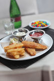 Fish and Chips. Serve with source and ketchup Royalty Free Stock Photo