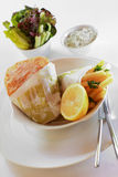 Fish and Chips. Delicious fish and chips with salad and tartar sauce at the side royalty free stock photos
