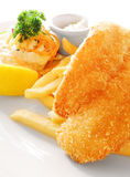Fish and chips. Fried fillet of fish with potato chips - An image showing the dish of traditional Great Britain style deep fried fish and chips, coated with Royalty Free Stock Photos
