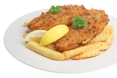 Fish & Chips. Breaded cod fillets with crinkle-cut chips Royalty Free Stock Photography