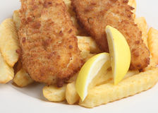 Fish and Chips. Traditional breaded cod and chips with lemon Stock Photo