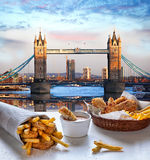 Fish and Chips against Tower Bridge in London, England Royalty Free Stock Photo