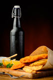 Fish, chips and beer bottle Royalty Free Stock Images