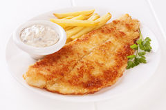 Fish and Chips. Breaded fish with tartare sauce and chips stock photo