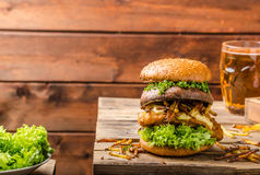 Fish and Chips Burger with grilled portobello stock photography