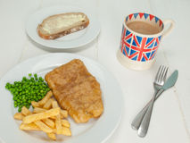 Fish and chips with a cup of tea and bread and butter Stock Image