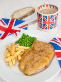 Fish and chips with a cup of tea  bread and butter and union jac Royalty Free Stock Images