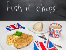 Fish and chips with a cup of tea  bread and butter and union jac Royalty Free Stock Image