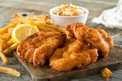Fish and Chips. Delicious homemade fish and chips with coleslaw and lemon garnish Royalty Free Stock Photography