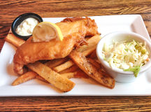 Fish and chips dish in british pub. Stock Image